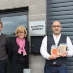 Andrew Chatten, owner at O'Chatten Smokery, pictured with Jeremy Wilson and Caroline Whiteside from the John Wilson Memorial Trust